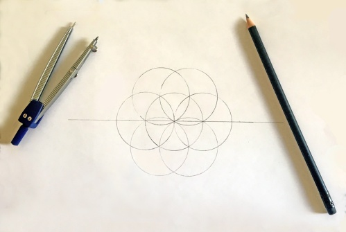 Drawing overlapping circles with compass and pen